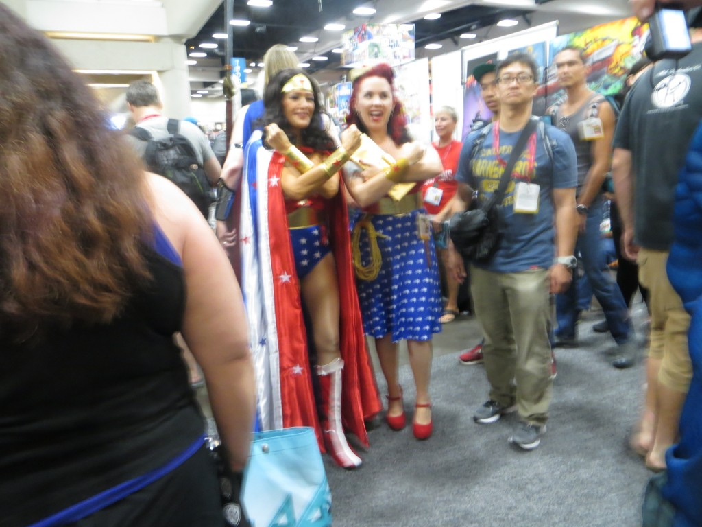 Photo--Golden age Wonder Woman and Steampunk Wonder Woman pose at Comicon 2014